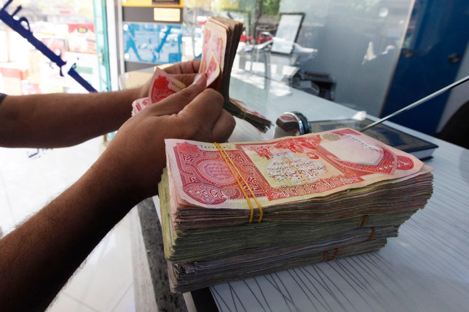 خفض قيمة الدينار العراقي